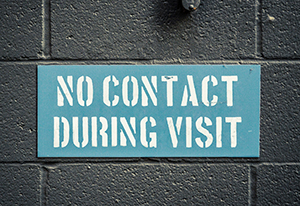 Prison sign that says No Contact During Visit
